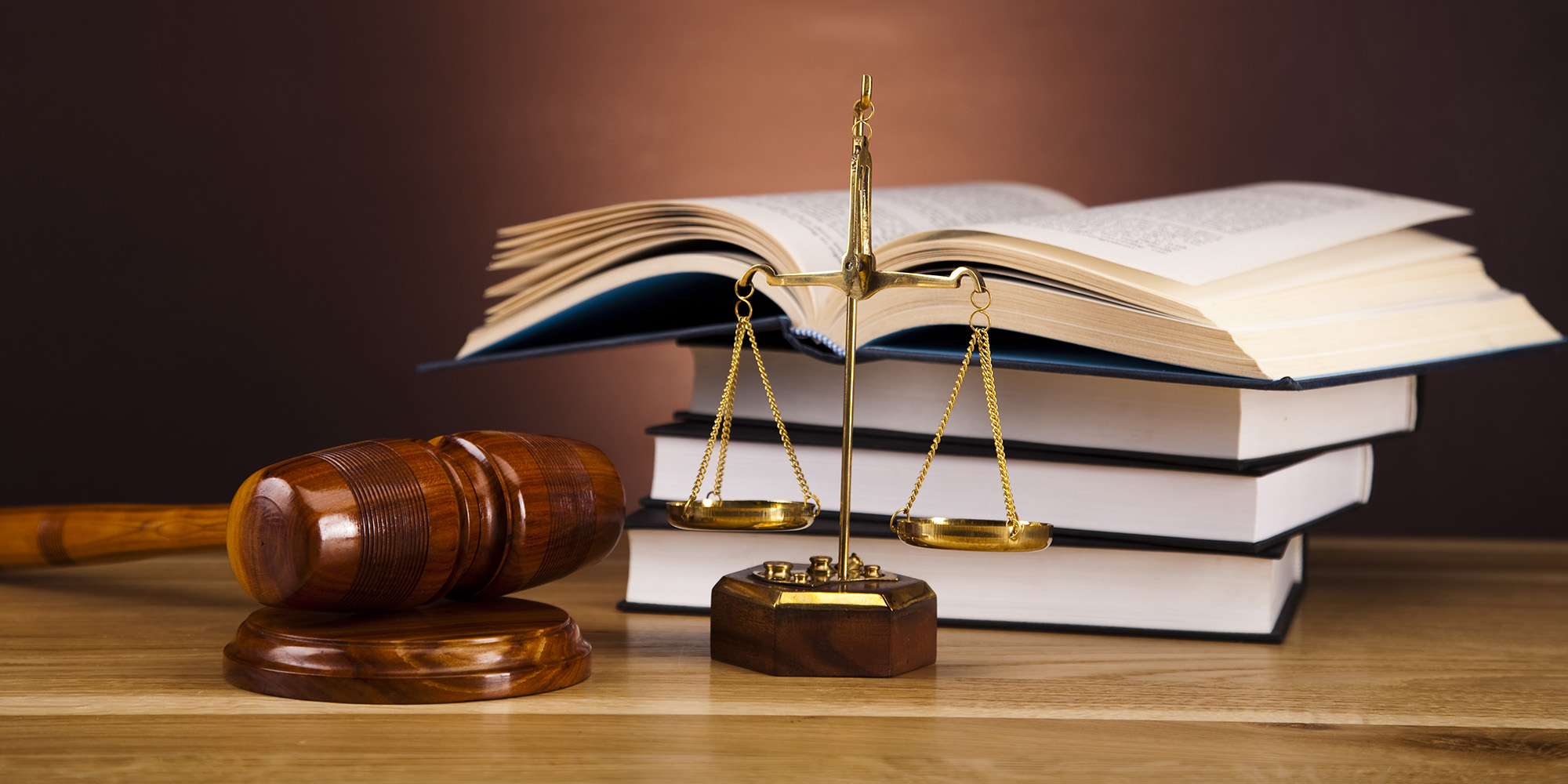 Court gavel. Scales of justice. Law books